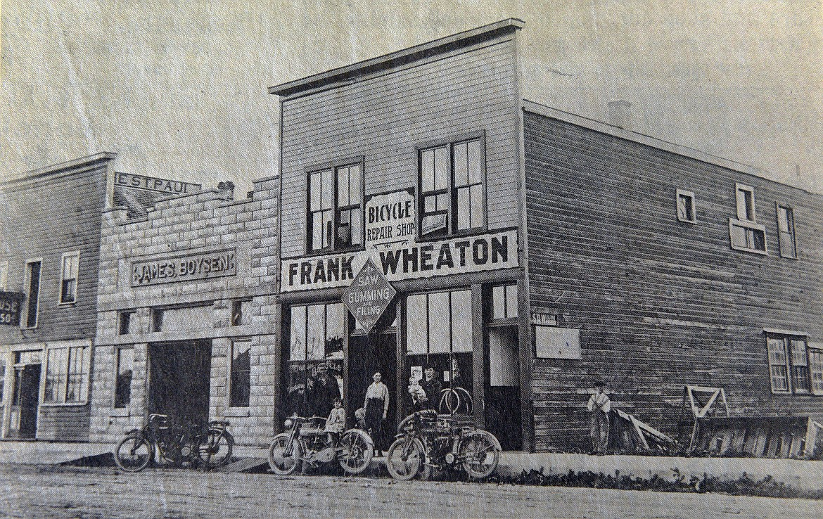 A young Frank Wheaton posed with his wife and little children in front of his store on First Avenue West in Kalispell. (Photo provided)