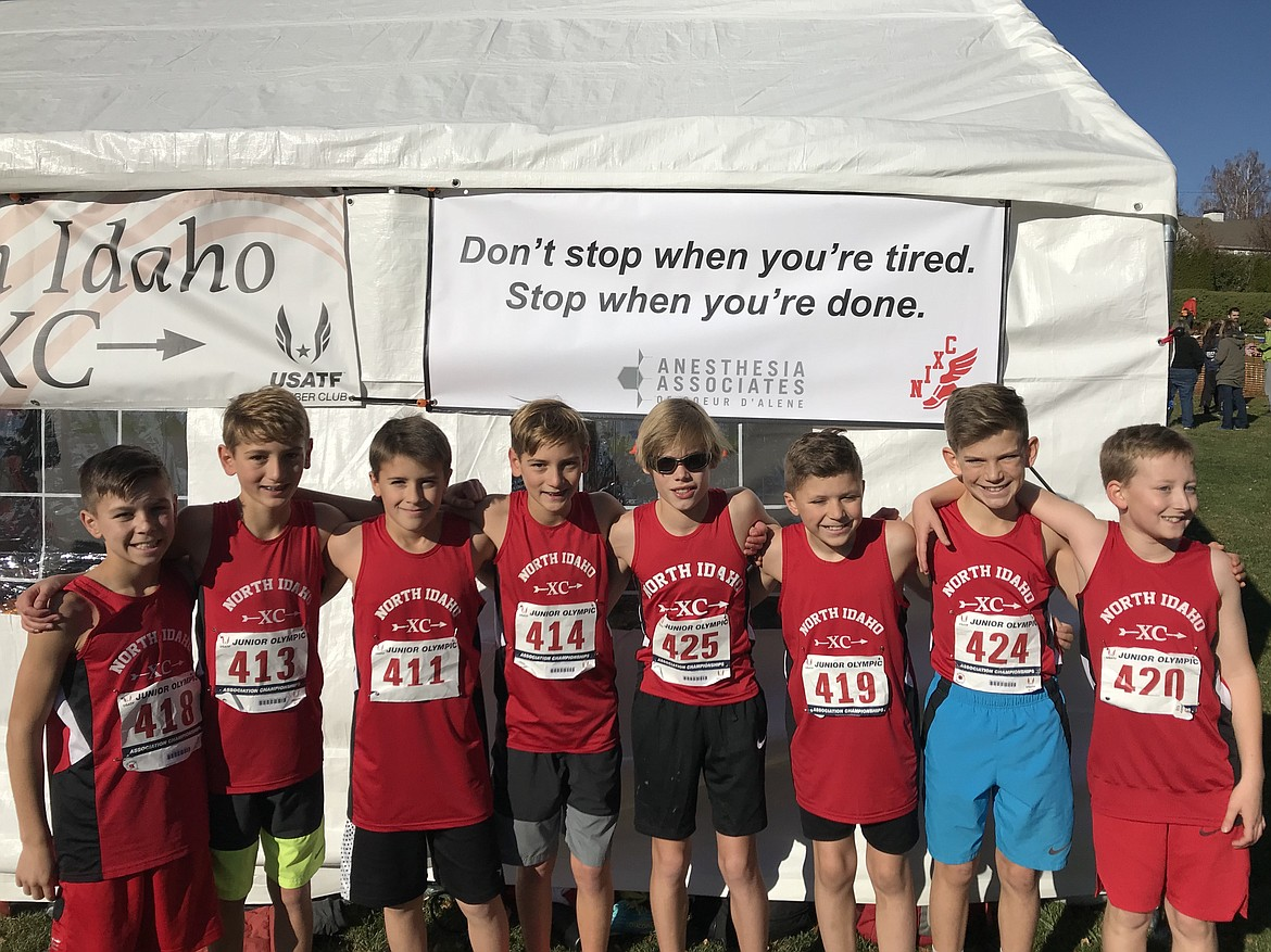 Courtesy photo The North Idaho Cross Country 11-12 boys team placed first out of 12 teams at the USA Track and Field Region 13 Junior Olympic Championship on Saturday in Yakima, Wash. From left are Ethan Hickok, Max Cervi-Skinner, Lars Bazler, Zack Cervi-Skinner, Neil McCarthy, Owen Hickok, Lachlan May and Alex Jones.