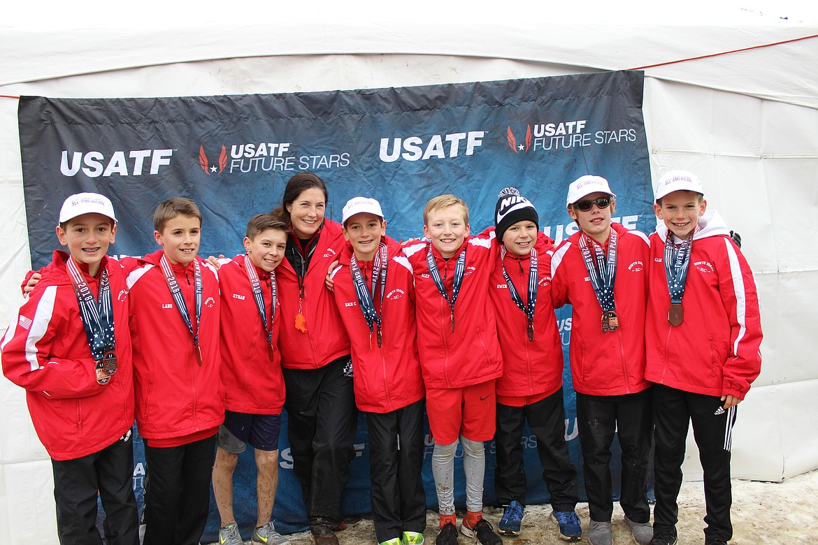 Courtesy photo North Idaho Cross Country's boys 11-12 year-old team placed third at the USA Track and Field Jr. Olympic National Cross Country Championship on Saturday in Reno. From left are Max Cervi-Skinner, Lars Bazler, Ethan Hickok, coach Erin Lydon Hart, Zack Cervi-Skinner, Alex Jones, Owen Hickok, Neil McCarthy and Lachlan May.
