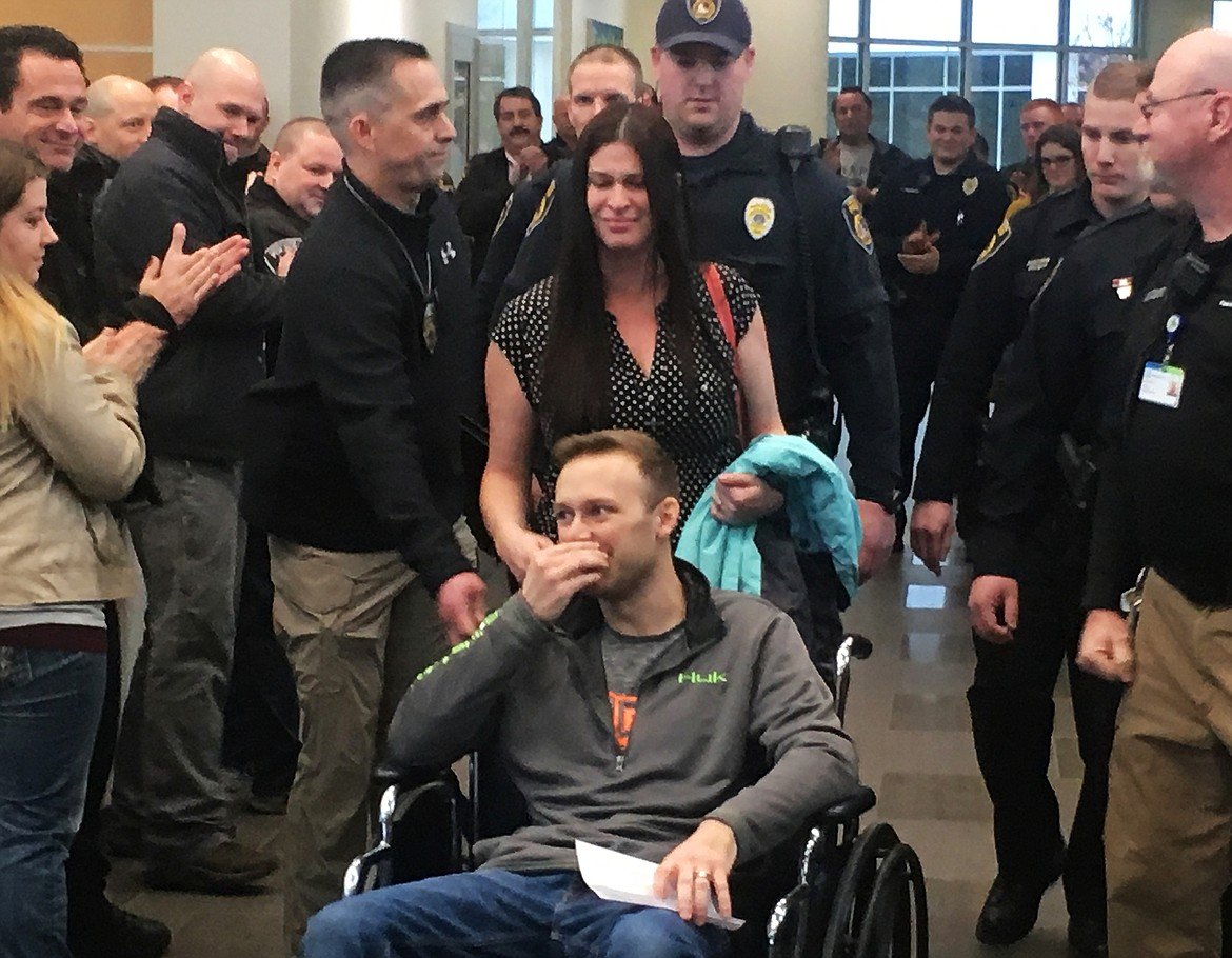 LOREN BENOIT/Press file Fellow Coeur d'Alene Police Department officers show their support as Officer Charles Hatley is escorted from Kootenai Health on March 2, 2018. Hatley was shot in the line of duty a year ago.