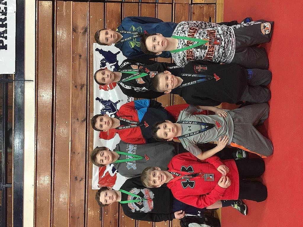 <p>Courtesy photo</p><p>Team Real Life wrestlers traveled to Twin Falls last weekend for the Idaho state</p><p>middle school championships as well as the USA/Idaho state wrestling</p><p>championships at Twin Falls High School.</p><p>There was a special ceremony that took place at the tournament to</p><p>acknowledge last year's USA/Idaho Triple Crown winners. A Triple Crown</p><p>winner is a wrestler that wins the USA/Idaho event in a given year for each</p><p>Folkstyle, Freestyle and Greco-Roman wrestling. Team Real Life members accepted two Triple Crown trophies for former teammates and current Post Falls High School wrestlers Ridge Lovett and Wyatt Shelly, who are preparing for the high school regional tournament.</p><p>Pictured in the front row from left are Roddy Romero, Byson Huber, Rider Seguine and</p><p>Braxton Mason; and back row from left, Jacob Engles, Ethan Miller, Dominique Jessos, Brelane Huber and Lane Reardon.</p><p>Placing at the middle school tournament on Friday night were Roddy Romero, 2nd; Brelane Huber, 4th; Ethan Miller, 4th; Dom Jessos, 5th; Lane Reardon, 5th and Braxton Mason, 6th.</p><p>Team Real Life Champions at the USA/Idaho wrestling championships were Byson Huber and Rider Seguine. Their championship status at this tournament earned them the first leg of a potential Triple Crown.</p><p>Others placing in the USA/Idaho state wrestling championships on Saturday were John Rudebaugh, 2nd; Roddy Romero, 2nd; Brelane Huber, 3rd; Lane Reardon, 3rd; Ethan Miller, 4th; Jacob Engles, 5th and Dom Jessos, 5th.</p>