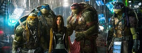 """<p>This image released by Paramount Pictures shows, from left, Michelangelo, Leonardo, Megan Fox, as April O'Neil, Raphael, and Donatello in a scene from """"Teenage Mutant Ninja Turtles."""" This image released by Paramount Pictures shows, from left, Michelangelo, Leonardo, Megan Fox, as April O'Neil, Raphael, and Donatello in a scene from """"Teenage Mutant Ninja Turtles.""""</p>"""