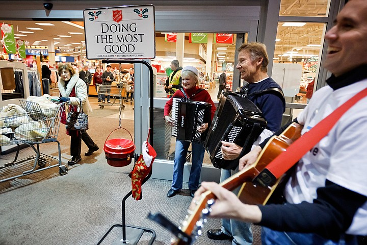 """<p>JEROME A. POLLOS/Press John Weston, right, Jim O'Brien and his wife Shirley O'Brien entertain shoppers and donation givers Tuesday at Fred Meyer in Coeur d'Alene has they help to draw in donations for the Salvation Army bell ringer. The O'Brien's, who tour the west performing polka music, have """"played the kettles"""" in San Diego, Tucson and now Coeur d'Alene to help increase donations for the annual fundraising effort.</p>"""