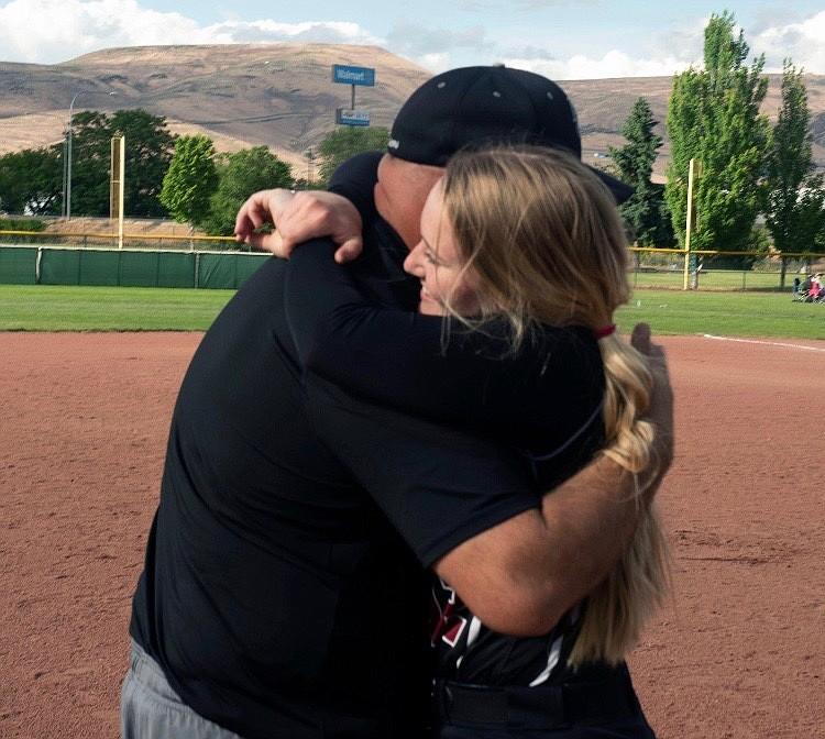 Courtesy photo ACH senior Kendel Correia shares a hug with her dad, ACH head baseball coach Mike Correia.