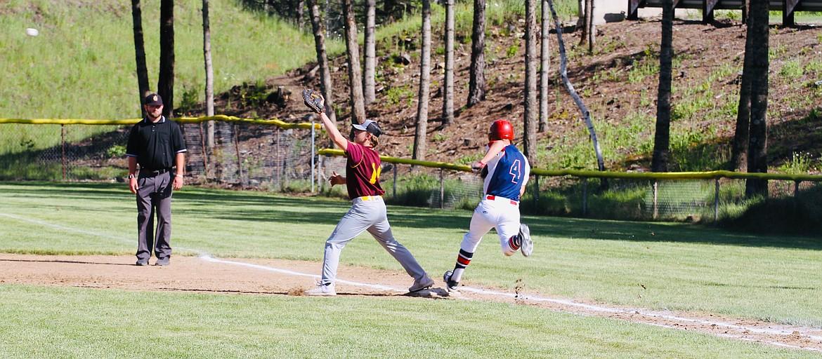 First baseman Parker Neff reaches for a late throw during Silver Valley's loss to Sandpoint.