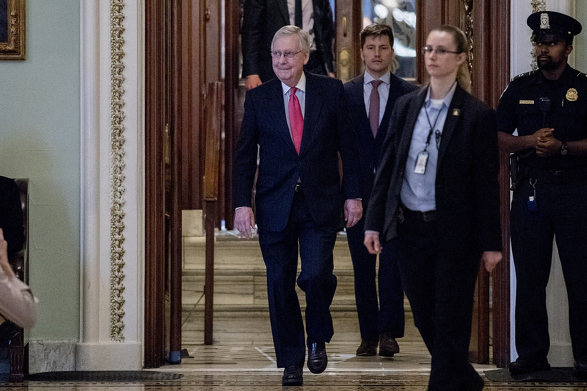 Senate Majority Leader Mitch McConnell of Ky. leaves the Senate chamber on Capitol Hill, Wednesday, March 25, 2020, in Washington. (AP Photo/Andrew Harnik)