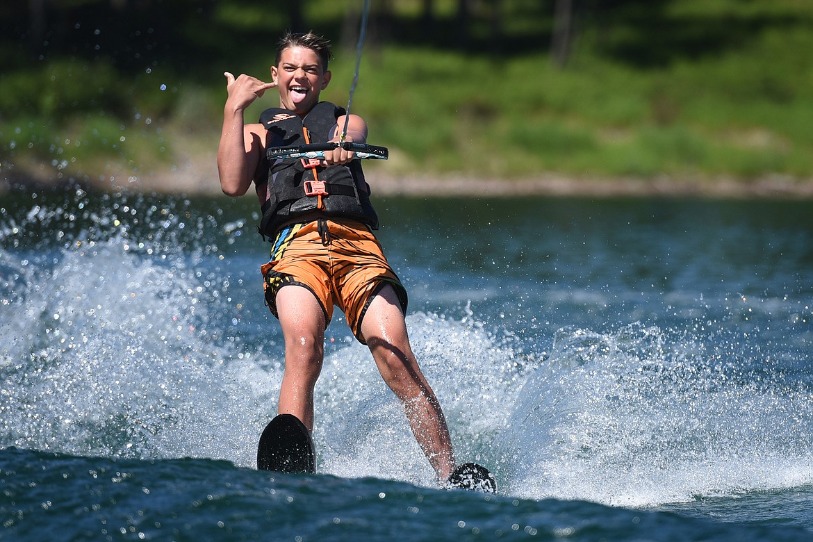 Kalispell's Ashten Nelson shows his enthusiasm during his first time waterskiing with Flathead Wakeboard Academy. (Jeremy Weber/Bigfork Eagle)