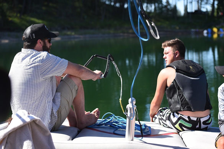 Flathead Wakeboard Academy owner Drew Hollinger goes over techniques with Kalispell's Kaden Nelson before hitting the lake. (Jeremy Weber/Bigfork Eagle)