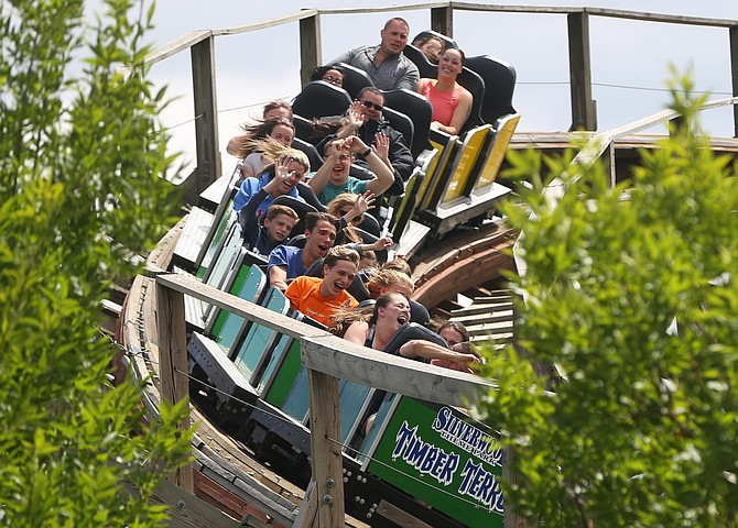 Park guests rip around a turn on Timber Terror at Silverwood Theme Park in Athol during the 2018 season. Because of coronavirus restrictions, Silverwood this year is expecting the park to be at a limited capacity with rigorous sanitation and social distancing requirements to keep its guests safe.