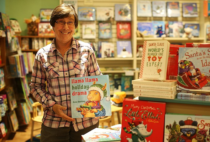 Melissa DeMotte, owner The Well-Read Moose Bookstore in Riverstone, is a retailer who sees things picking up this holiday retail season especially with kids book sales. (LOREN BENOIT/Business Journal)