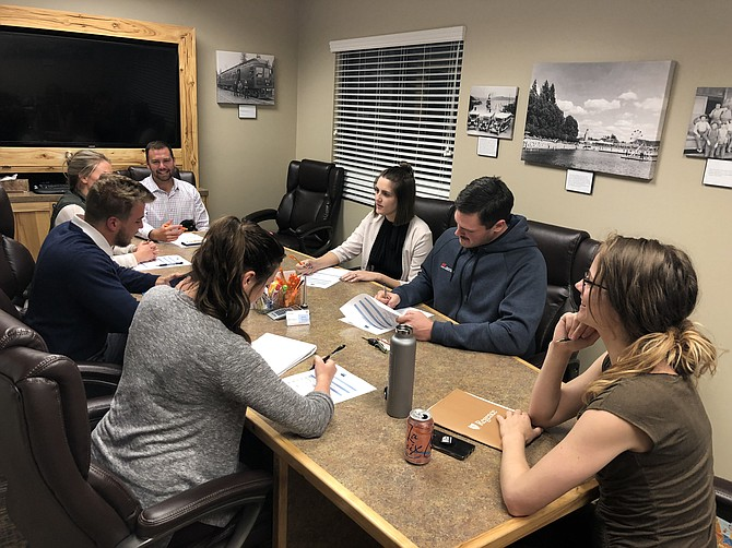 Board members of Kootenai County Young Professionals share ideas as they engage in conversation at their Oct. 4 meeting. Counter-clockwise, from center: Ashley Yates, James Perkinson, Heather Twidt, Jesse Johnson, Cassidy Bones, Arwyn Robinson and Jacob Bonwell. (Courtesy photo)