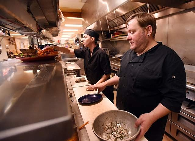 Josh Auerhammer and Sara Penneman, line cooks at Sykes in Kalispell, keep going even after the lunch rush has ended. The diner has reduced its hours to 7 a.m. to 3 p.m., but they are still open seven days a week.