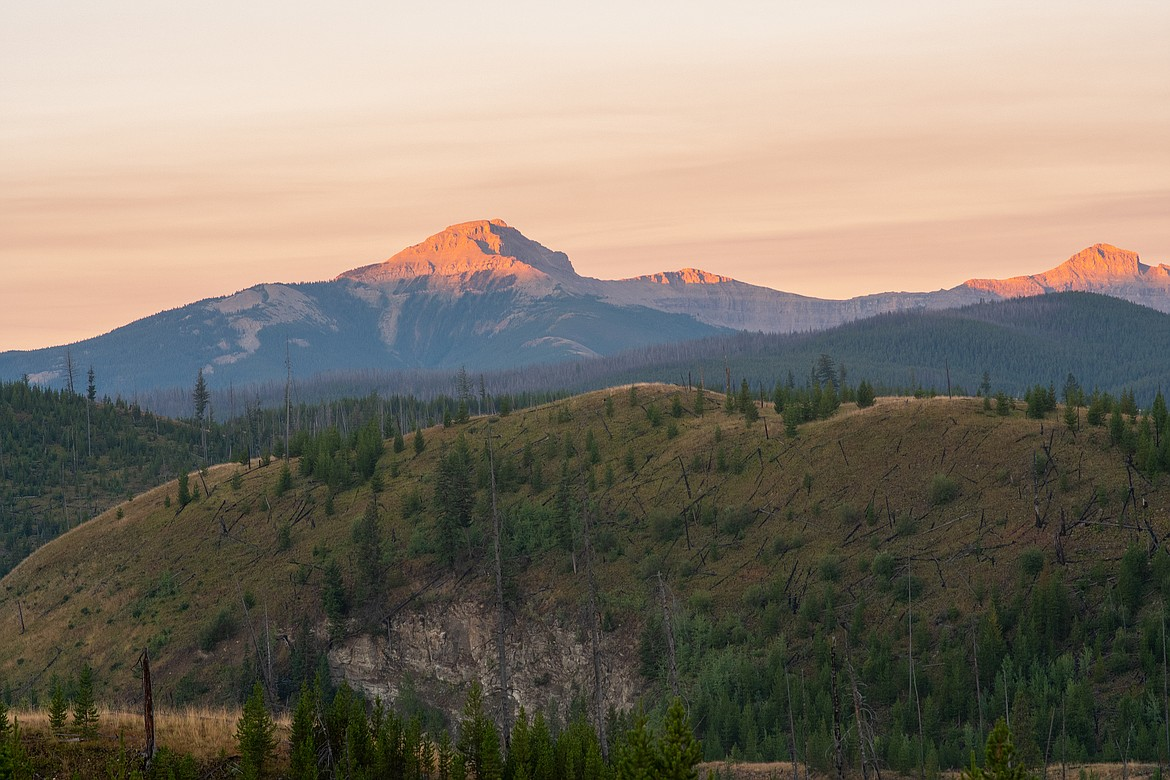 The sun strikes the high peaks of the Bob Marshall Wilderness.