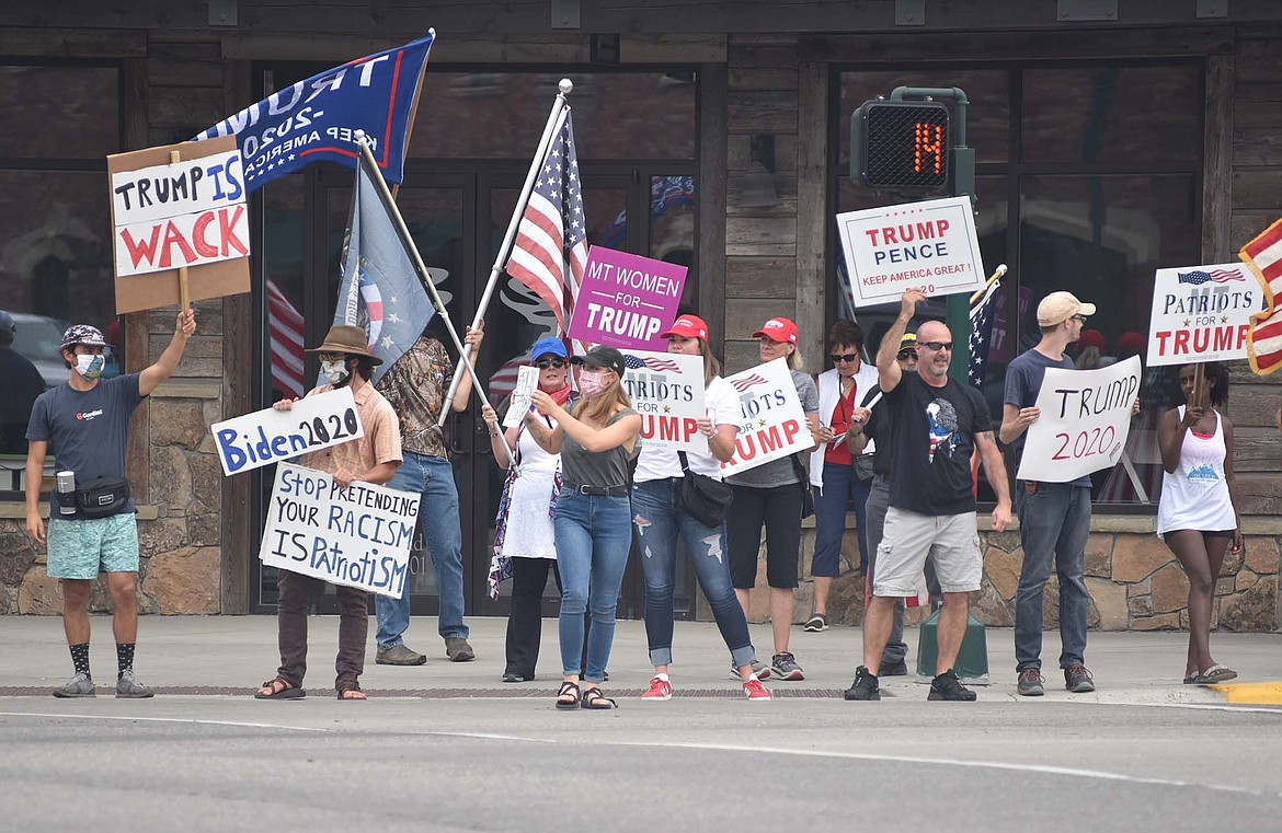 Supporters of Republican President Donald Trump, supporters of presidential candidate Democrat Joe Biden, along with those showing support for the Black Lives Matter movement stand near each other at the corner of Second Street and Baker Avenue on Monday, Aug. 24. (Heidi Desch/Whitefish Pilot)