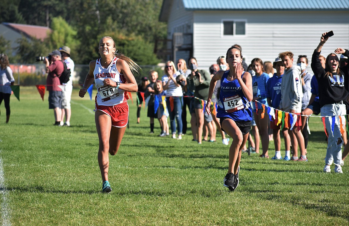 Sophomore Ara Clark attempts to beat out Coeur d'Alene's Anne Marie Dance during Friday's home meet.