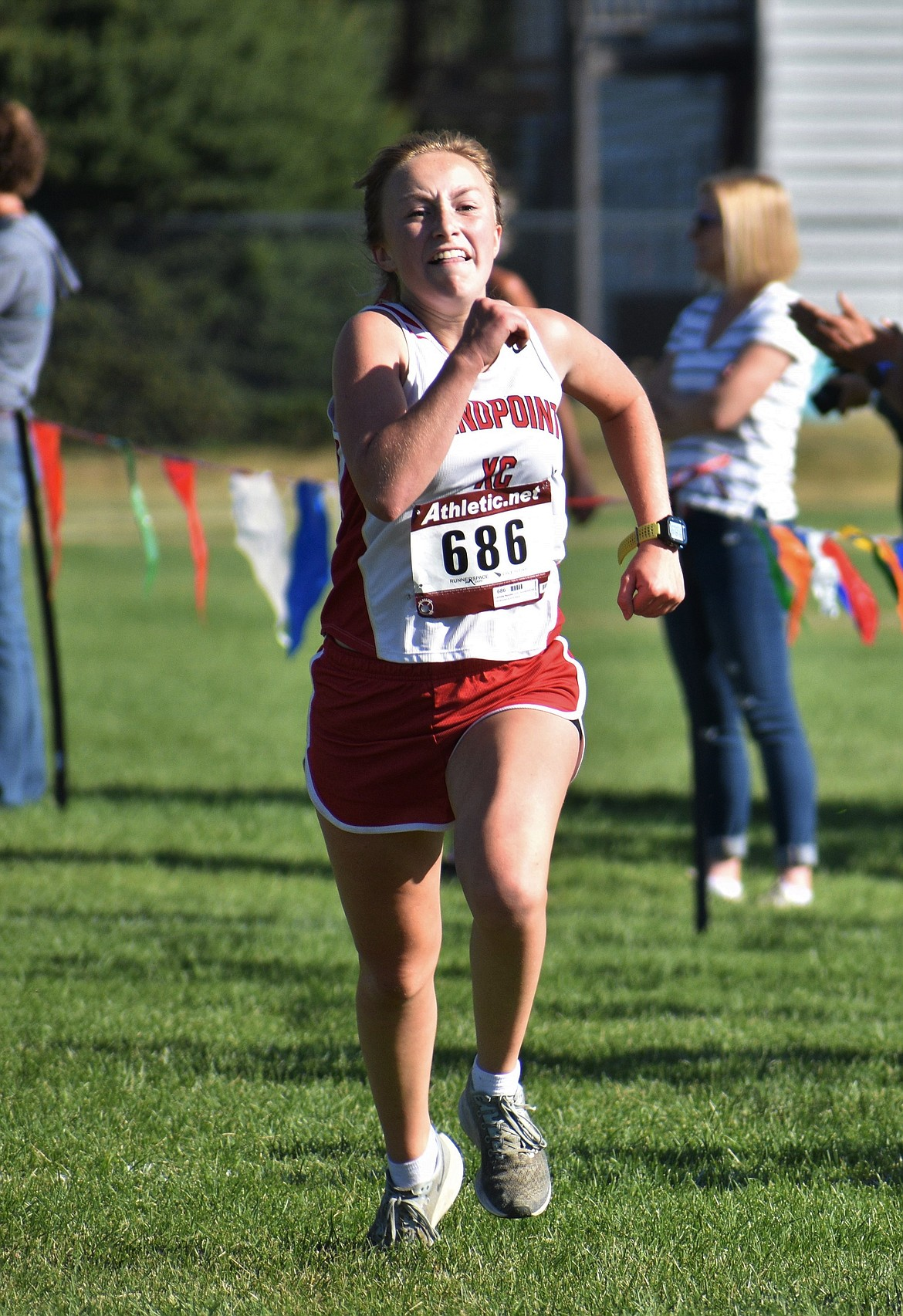 Senior captain Camille Neuder nears the finish line during Friday's meet at Travers Park.