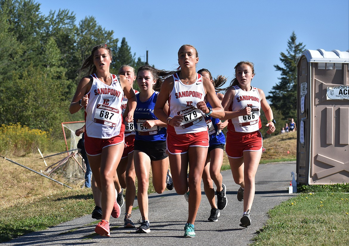 A pack of Sandpoint runners compete in Friday's meet.