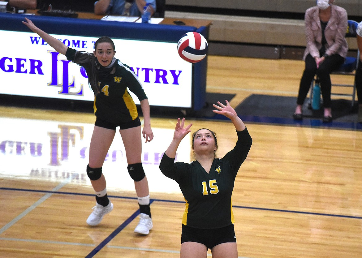 Whitefish's Jenny Patten goes for the set against the Loggers in Libby last week. (Will Langhorne/The Western News)