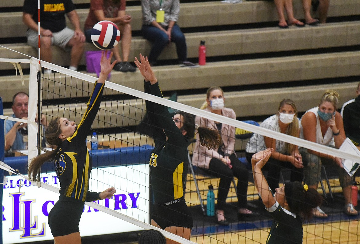 Bulldog Gabby Herrick challenges a Libby player at the net last week in Libby. (Will Langhorne/The Western News)