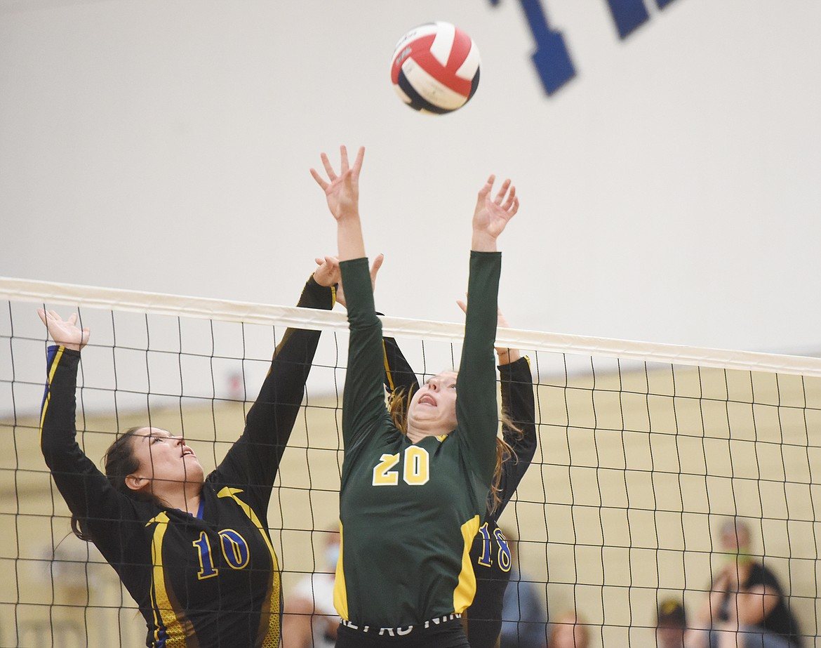 Bulldog Mikenna Ells rises up at the net against the Loggers in Libby last week. (Will Langhorne/The Western News)
