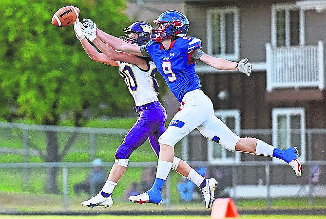 Isak Epperly leaps up to catch a pass last Friday when the Vikings faced off against Cutbank.