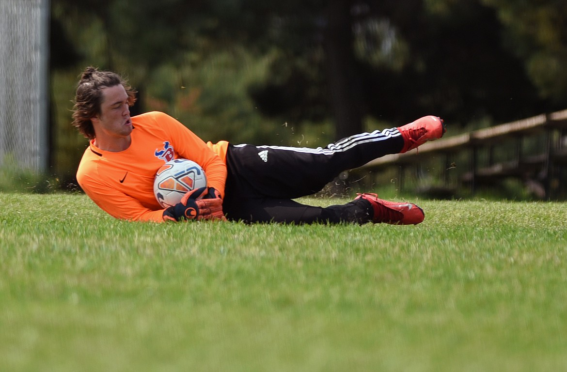 Vikings keeper Caden Riedesel makes a sliding save against the Blue Devils.