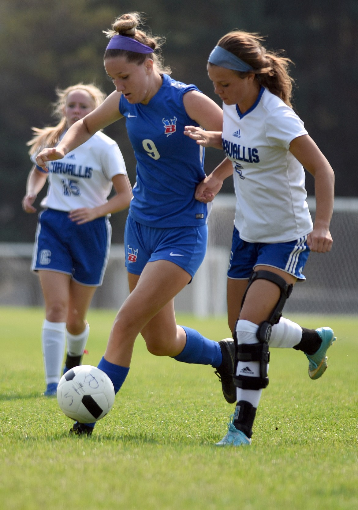 Brette Guenzler battles for control of the ball against Corvallis Saturday.