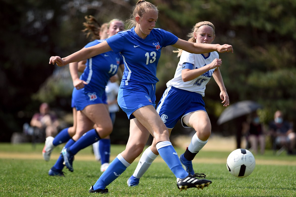 Callie Gembala pushed the ball forward against the Lady Blue Devil defense.
