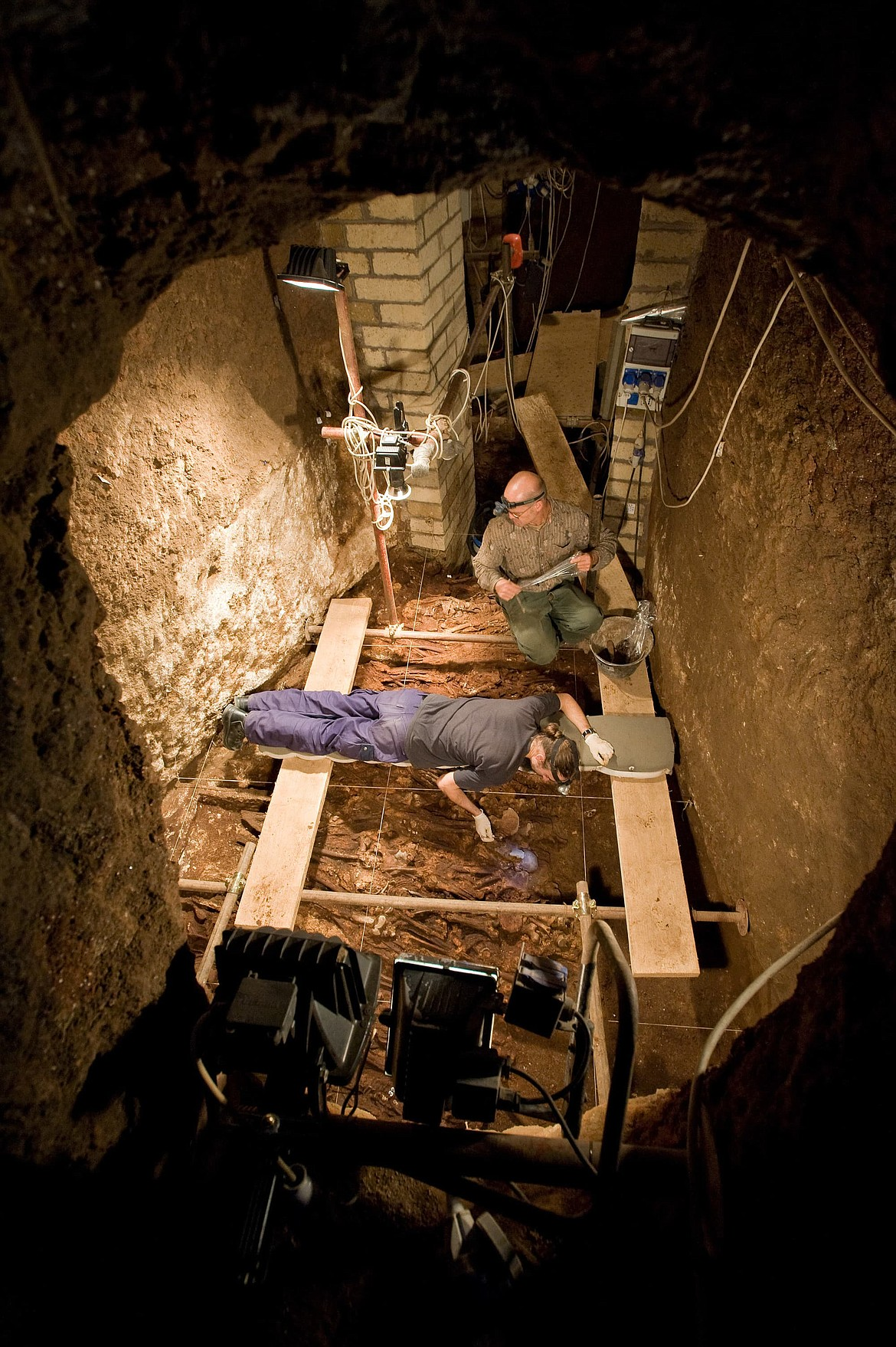 Excavating in the St. Peter and St. Marcellin catacombs beneath the ancient Via Labicana where 20,000 to 25,000 bodies were buried in the 4th century A.D. (2008).