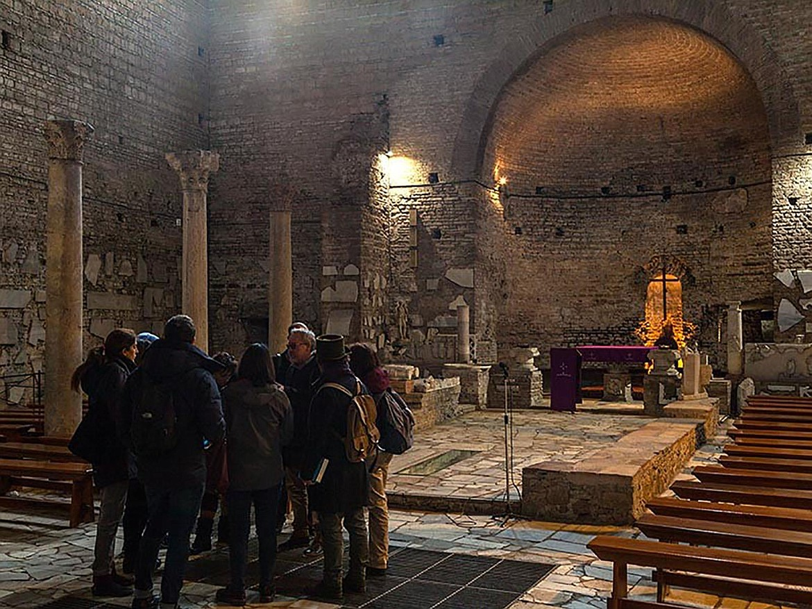 Tour visitors shown here are in the basilica in St. Domatilla Catacomb, the only basilica in any of Rome's catacombs; this one dedicated to the martyrs Nereo, Achilleo and Saint Petronilla, daughter of St. Peter.