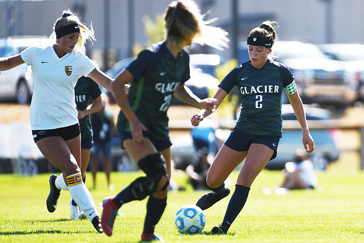 Glacier's Emily Cleveland (2) moves the ball upfield against Missoula Sky Big at Glacier High School on Thursday. (Casey Kreider/Daily Inter Lake)