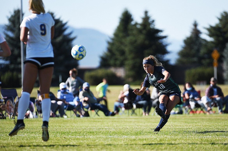 Glacier's Madison Becker (18) kicks a free kick in the second half against Missoula Big Sky at Glacier High School on Thursday. (Casey Kreider/Daily Inter Lake)