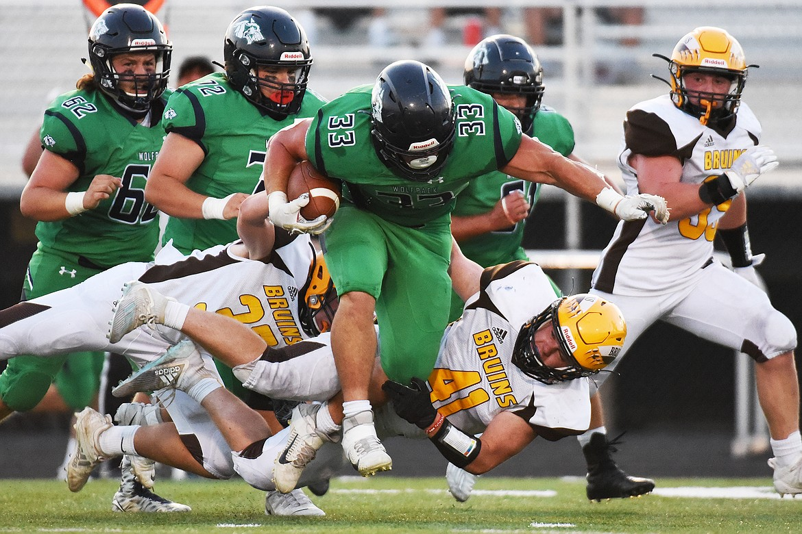 Glacier running back Jake Rendina (33) picks up yardage after a second quarter reception against Helena Capital at Legends Stadium on Friday. (Casey Kreider/Daily Inter Lake)