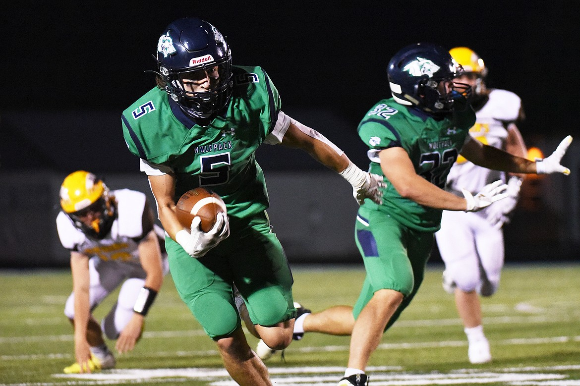 Glacier wide receiver Cole Johnson (5) heads upfield after a third quarter reception against Helena Capital at Legends Stadium on Friday. (Casey Kreider/Daily Inter Lake)