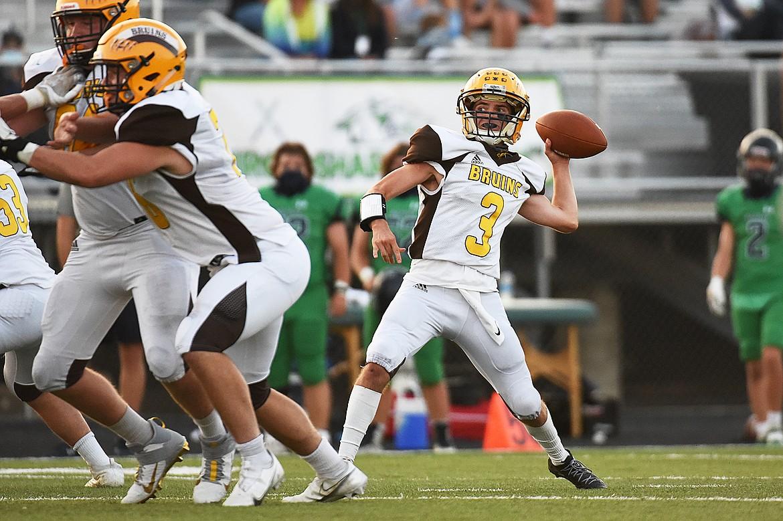 Helena Capital quarterback Matt Burton (3) looks to throw in the first half against Glacier at Legends Stadium on Friday. (Casey Kreider/Daily Inter Lake)