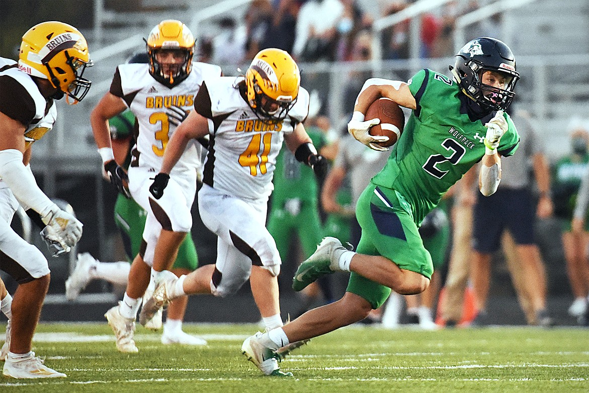 Glacier wide receiver Connor Sullivan (2) heads upfield after a second-quarter reception against Helena Capital at Legends Stadium on Friday. (Casey Kreider/Daily Inter Lake)