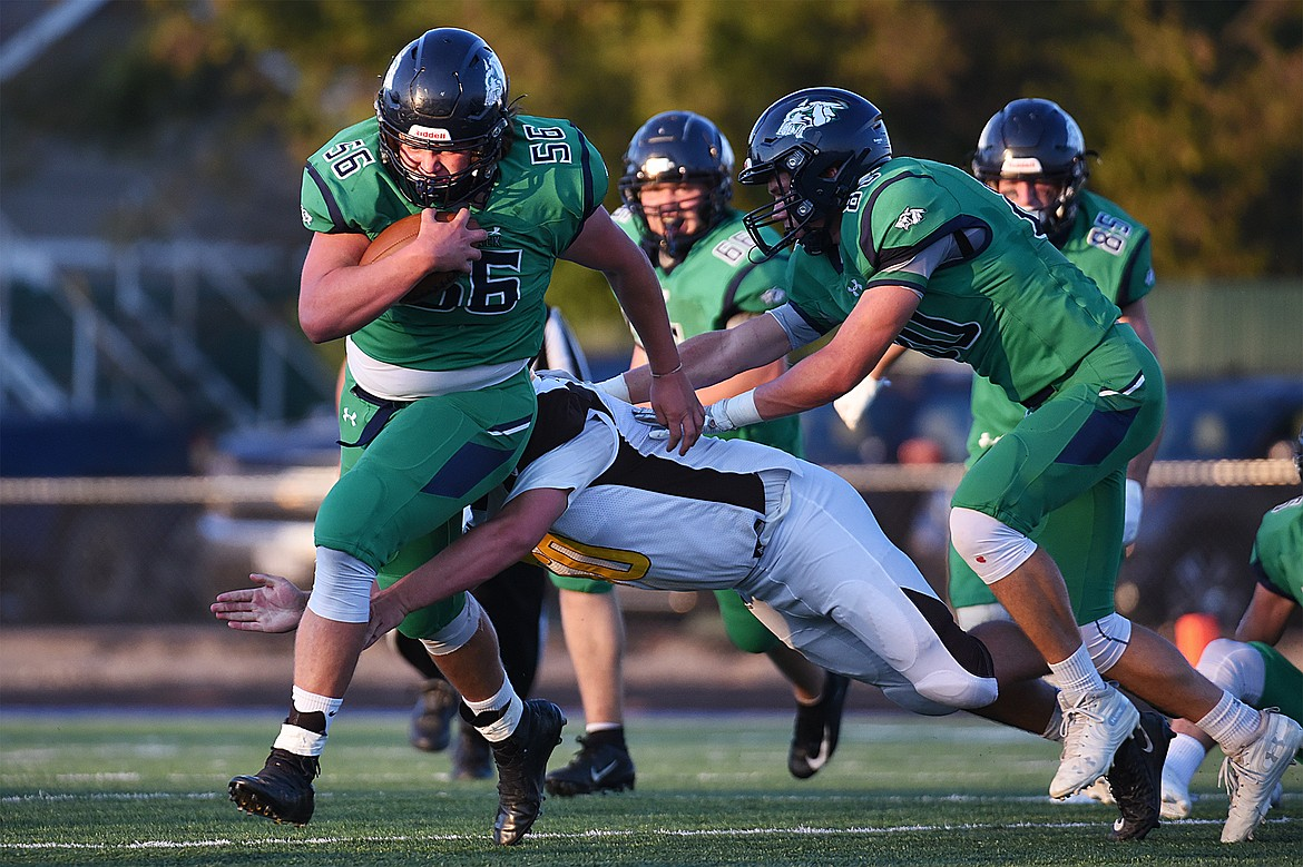 Glacier defensive lineman Rocco Beccari (56) scoops up a fumble by Helena Capital in the first quarter at Legends Stadium on Friday. (Casey Kreider/Daily Inter Lake)
