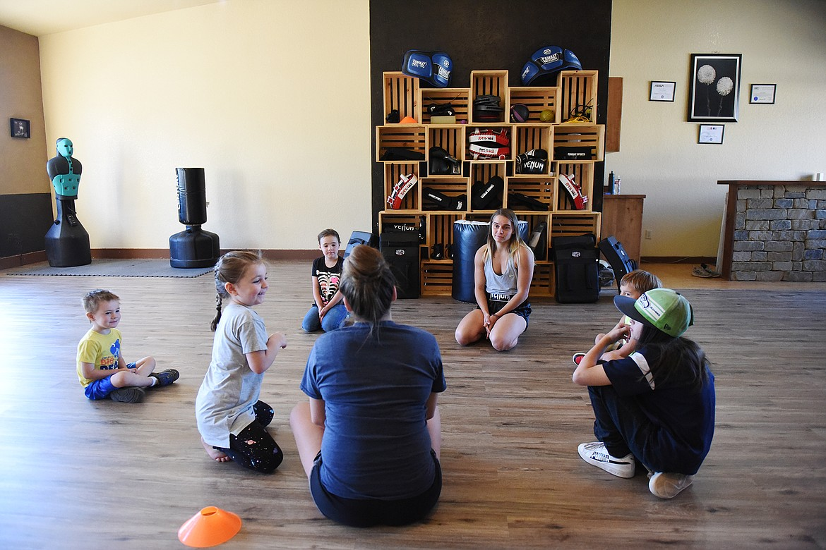 Jenee, left, and Renee Sandlin work with a group of kids in one of the youth classes at Mighty Mouse Muay Thai in Columbia Falls on Wednesday, Sept. 9. (Casey Kreider/Daily Inter Lake)