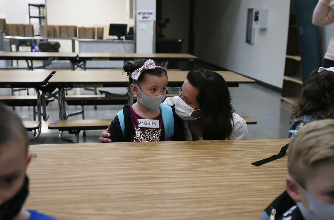 Irene Kloos comforts daughter McKinley Kloos as she starts her first day of kindergarten at Northwest Expedition Academy on Monday.