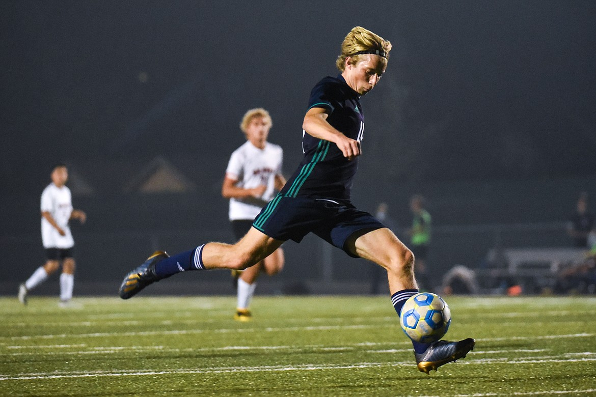 Glacier's Parker Creer (11) scores a first-half goal against Flathead during crosstown soccer at Legends Stadium on Tuesday. (Casey Kreider/Daily Inter Lake)