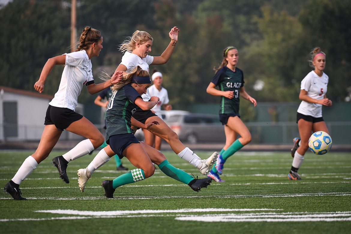 Glacier's Madison Becker (18) looks to shoot against Flathead during crosstown soccer at Legends Stadium on Tuesday. (Casey Kreider/Daily Inter Lake)