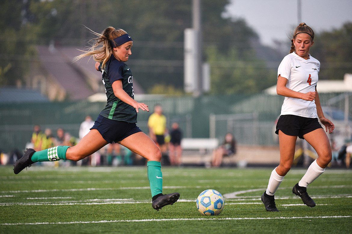 Glacier's Madison Becker (18) scores the lone goal of the match in the first half against Flathead during crosstown soccer at Legends Stadium on Tuesday. (Casey Kreider/Daily Inter Lake)