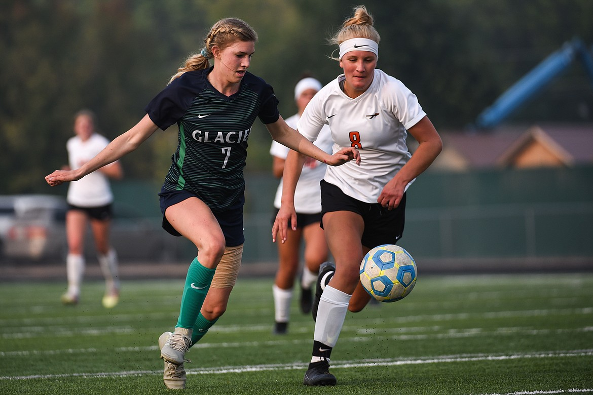 Glacier's Reese Leichtfuss (7) and Flathead's Chloe Mohatt (8) chase down a ball in the first half during crosstown soccer at Legends Stadium on Tuesday. (Casey Kreider/Daily Inter Lake)
