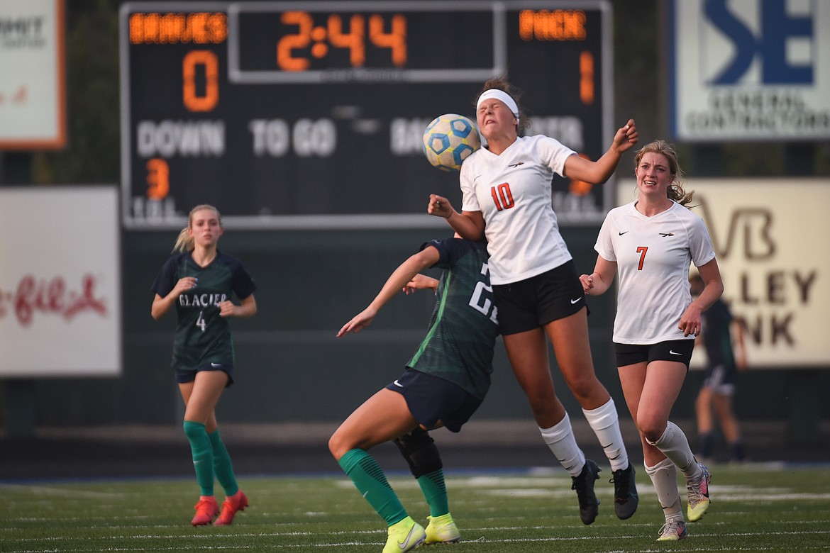 Flathead's Ashlynn Whiteman (10) battles for a header against Glacier's Taylor Brisendine (23) during crosstown soccer at Legends Stadium on Tuesday. (Casey Kreider/Daily Inter Lake)