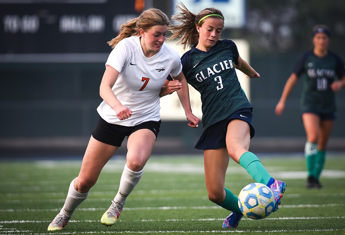 Flathead's Lily Tanko (7) and Glacier's Reagan Brisendine (3) battle for a ball during crosstown soccer at Legends Stadium on Tuesday. (Casey Kreider/Daily Inter Lake)