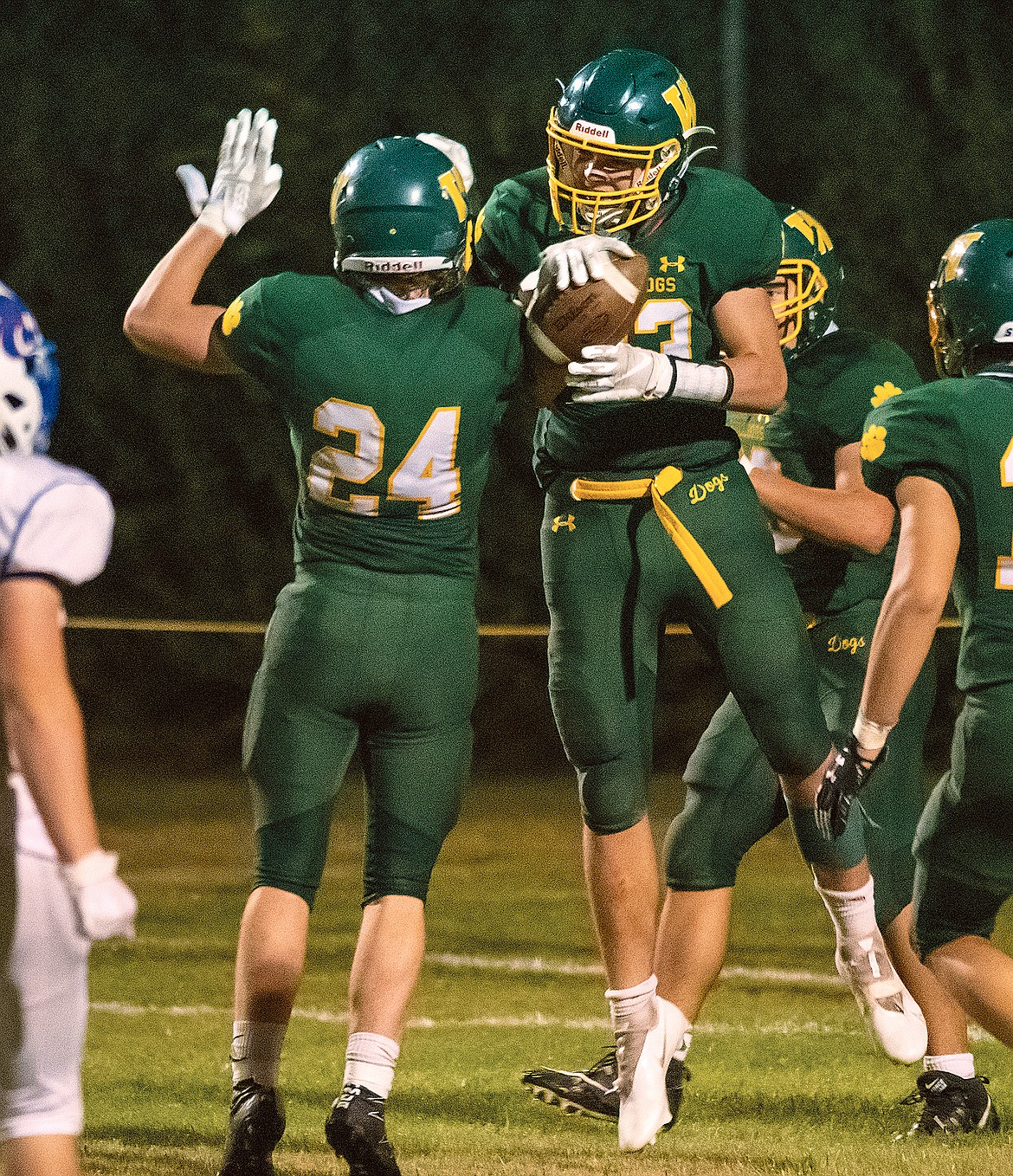 Ty Cameron celebrates a touchdown with Ty Schwaiger during the game against Columbia Falls Friday night. (Chris Peterson/Hungry Horse News)