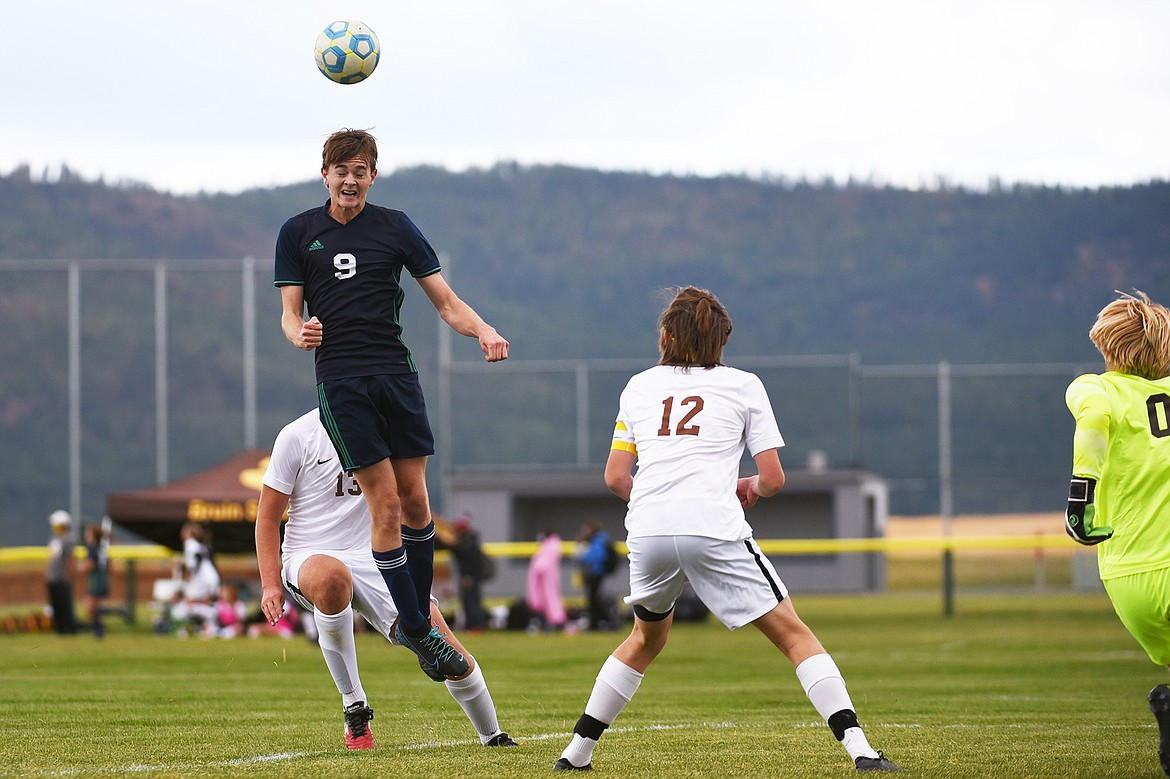 Glacier's Daniel Camp (9) heads a kick just wide of the net in the first half against Helena Capital at Glacier High School on Saturday. (Casey Kreider/Daily Inter Lake)