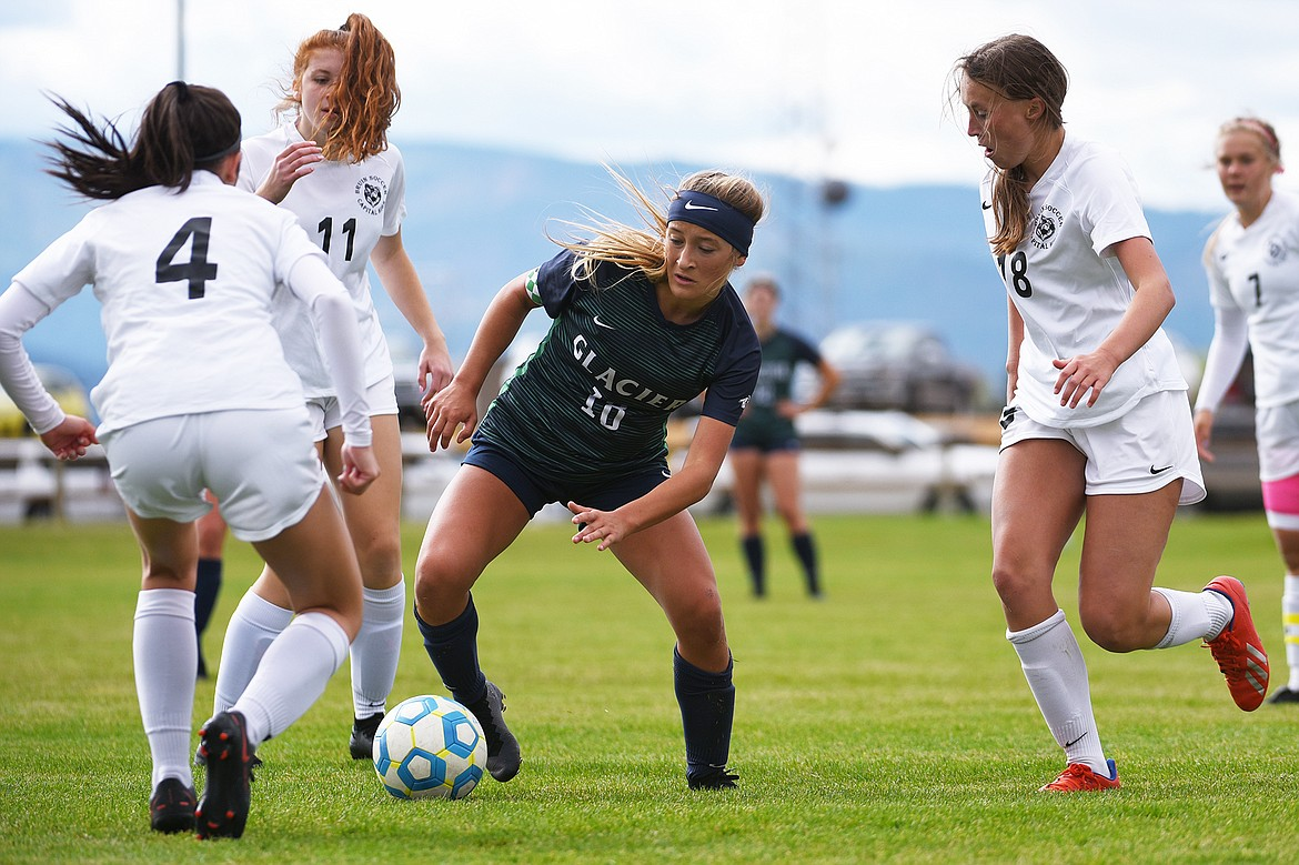 Glacier's Madison Becker (18) dribbles into traffic against Helena Capital at Glacier High School on Saturday. (Casey Kreider/Daily Inter Lake)