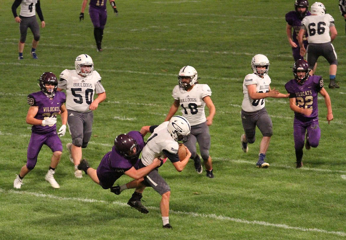 Kellogg's Austin Miller chased down and tackled Grangeville's kick returner during the first half of the Wildcats' home opening loss to the Bulldogs last Friday.