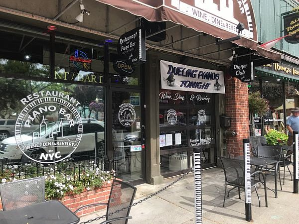 he NYC Piano Bar and restaurant on Sherman Ave. might be haunted. Owner Dan Schnatter says the Spokane Paranormal Society found multiple 'entities' in the joint - and even performed an exorcism last year.